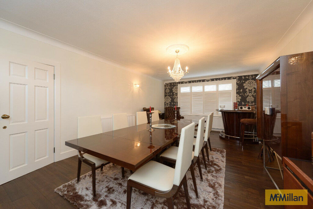 Beautiful art deco style dining room table and 8 cream leather chairs.