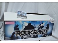 Rock Band game disc with one guitar, a drum kit and a microphone (Nintendo Wii)