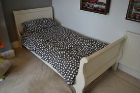 Childs Sleigh bed made by 'And So To Bed' painted cream wood