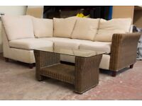 Beige corner sofa with rattan table