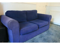 Free Blue two seater Sofa Bed in good condition.
