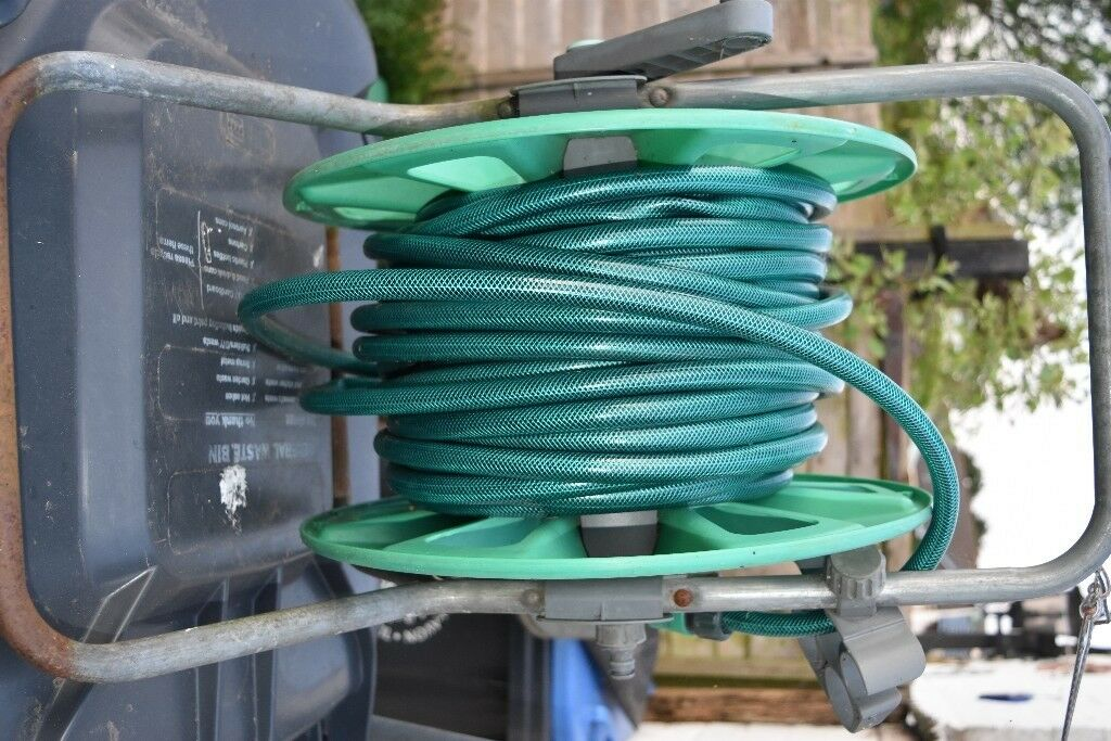 Good quality 26 metre garden hose and reel, hose new last season ...