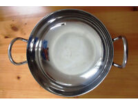 Balti dish with 2 handles. Made in India. Probably stainless steel, but unmarked.