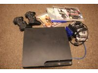 PS3 Slim with some games & controllers