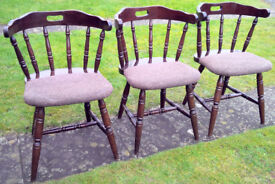 ARCHED BACKED SPINDLED 3No. WOODEN CHAIRS WITH PLAIN SEAT PAD UPHOLSTERY.