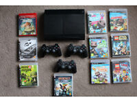 PlayStation 3 slim 500GB black console with 3 controllers and 10 games