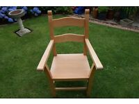 2 Upright Hand made Beech armchairs. Solid construction in good condition buyer collects.