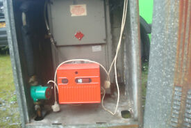 Firebird Boiler with Riello burner housed in outdoor cabinet.