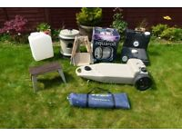 Various Caravan Accessories including Aquaroll; Wastemaster; water carriers; new windbreak, etc.