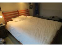 King size bed with wooden frame, mattress and 4 drawers