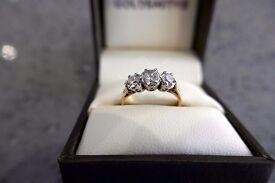 Lovely diamond ring. 3 diamonds = 1ct of diamonds 18 ct gold 0.5ct, 2x 0.25ct