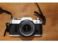 Canon AE-1 35mm camera with 28, 50 and 210 mm lenses plus flash