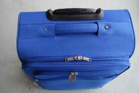 "Go Explore ""Signature"" Rolling 2-Wheel bright blue soft-sided suitcase in excellent condition."