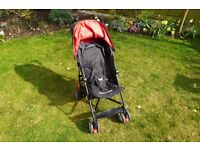 Kiddicare Pushchair, a Red and Black Buggy that's Lightweight, Compact and includes a Rain Cover