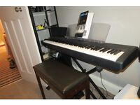 Yamaha piano, Yamaha stool, foot pedal, piano stand, music stand and teach yourself piano book.