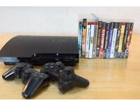 PS3 slim + 2 controllers + 14 games