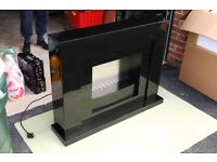 Next Black Gloss freestanding fireplace with electric fire