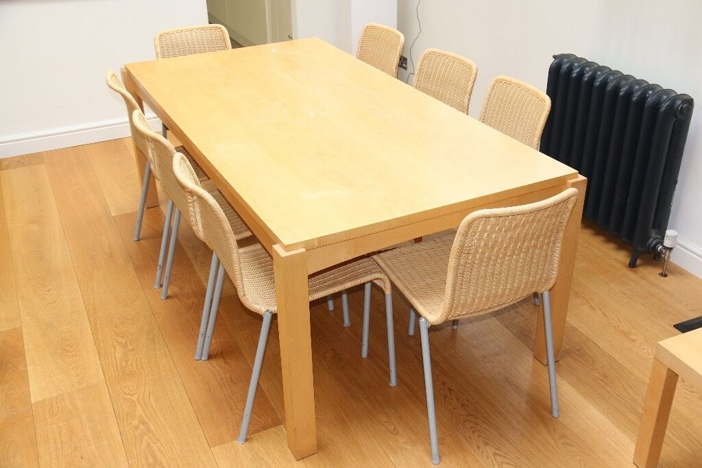 Light wood dining table and 8 chairs And small side table 200