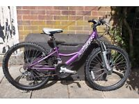 Girls' mountain bike with front suspension. Amethyst pulse
