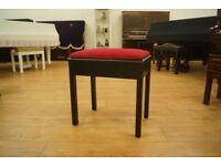 Black vintage piano stool