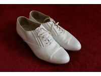 Two pairs of Italian leather white shoes, in great condition, hardly worn Size 8 and a half