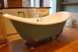 Freestanding double ended slipper cast iron roll top bath
