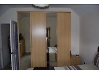 Large double wardrobe, chest of drawers and bedside table