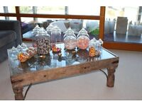 Assorted sized plastic sweet jars perfect for weddings or partys