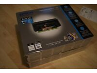 Epson Printer / Scanner - Only used once. Comes with unopened ink cartridges.