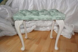 Green padded cushion dressing table with white leg, fire label attached , in good condition