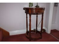 An attractive circular occasional table with draw.
