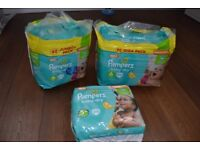 Pampers baby dry nappies for sale size 5+ / 6