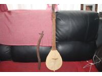 vintage carved african 1 string violin