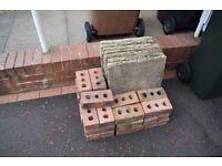 7 square York stone paving slabs & 27 building bricks