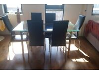 Large Glass Dining Table and Six Black Chairs