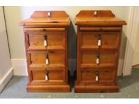 A pair of solid pine antique bedside chests, 3 drawer.