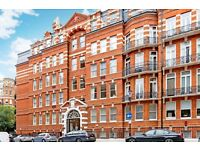 HOLLAND PARK: A spacious four bedroom apartment in stunning mansion block. ** SHORT LET**