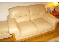 Cream leather 2 seat settee, matching footstool excellent condition RE ADVERTISED TIME WASTERS