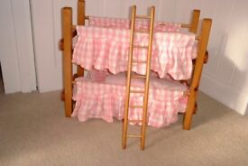 Handcrafted bunk beds for dolls with ladder and bedding