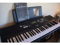 Yamaha EZ-220 Portable keyboard with 61 full size illuminating touch sensitive keys