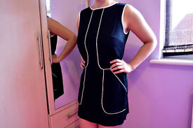 Short dark blue dress with pockets