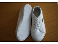Pair of Childrens Lacoste white casual trainer. Elasticated. V. Good condition