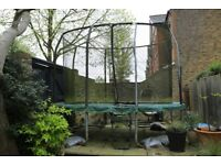 Trampoline, Jump King Oval with net and ladder, 8ft x 11.5ft approx