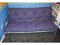 Futon double sofa bed on metal base with easy to pull out operation