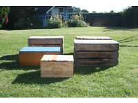 Vintage vine and apple crates recycled as storage boxes