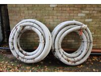 Two 25M rolls of 100mm OSMADRAIN plug together subsoil drainage pipe NEW but been standing in garden