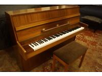 Modern German made upright piano with free matching stool and UK delivery available