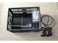 Mint condition PS3 Piano black 80GB with 2 controllers, games, BluRay player