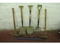 work tools, spades,fork, sledge hammer, pick axe, crow bars