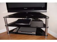 TV stand in black glass and chrome.